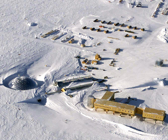 This handout photo dated 31 October 2002 shows an aerial view of the new elevated station (bottom-C) being built at the US Amundsen-Scott South Pole Station in Antarctica. The new station, scheduled to be completed in 2007, is elevated to allow snow to drift underneath and is capable of being jacked up higher as snow accumulates. The new base will replace previous bases already buried under snow, with the original 1957 base about 10 meters (36 feet) under and the current dome base (pictured far L) also becoming buried. AFP PHOTO/USAF-NATIONAL SCIENCE FOUNDATION/HO (Photo credit should read DAVID MCCARTHY/AFP/Getty Images)