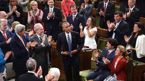 U.S. President Barack Obama, centre, is greeted by a standing ovation in the House of Commons in Ottawa on Wednesday, June 29, 2016. Adrian Wyld/CP