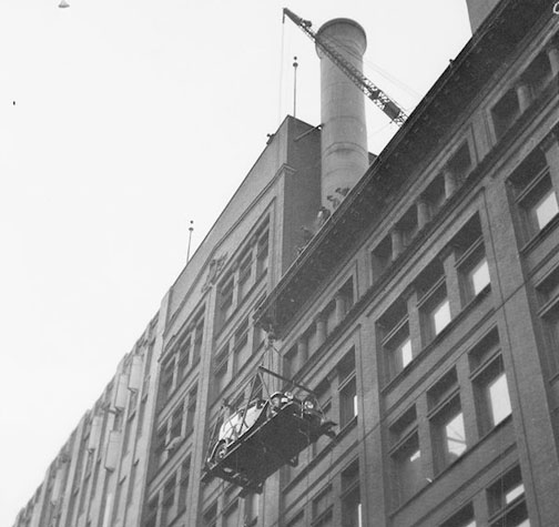 Motor Show, first car being hoisted, side, Simpson Bldg. - January 4, 1929